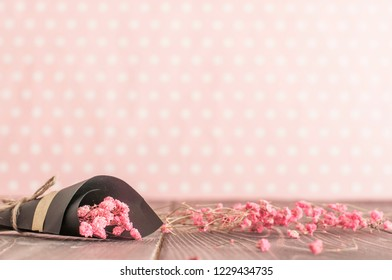 Bouquet of pink flowers  on flat lay wooden background