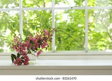 bouquet of pink flowers on a window