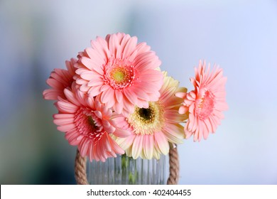 Bouquet of pink gerberas on blurred background, close up