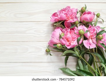 Bouquet of pink peonies  on a wooden table. Gift Valentine's Day.