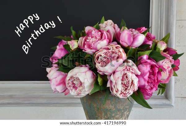 Bouquet pink peony flowers. Frame with chalk board and written happy birthday text.
