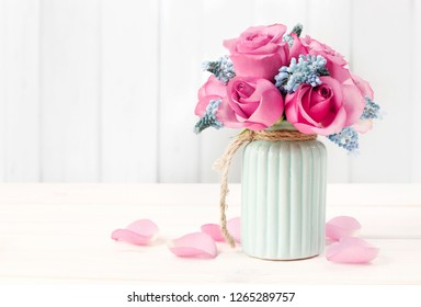 Bouquet of pink roses and blue muscari flower (Grape Hyacinth), copy space.