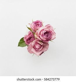 Bouquet of pink roses on a white background. Flat lay