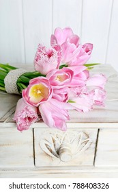Bouquet of pink tulips lying on the table.