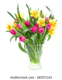 bouquet of pink tulips and yellow daffodils in vase isolated on white background