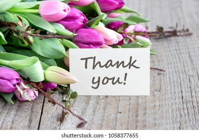 bouquet with pink and violet tulips and card with text: Thank you