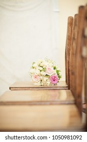 a bouquet of pink and white roses on a chair, wedding decor, flo