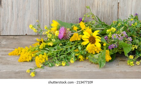 A bouquet of prairie wildflowers laying on a weathered backdrop