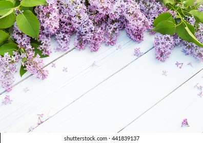 Bouquet of purple lilacs flowers on a light blue shabby wooden background. Vintage floral background with spring flowers. Copy space