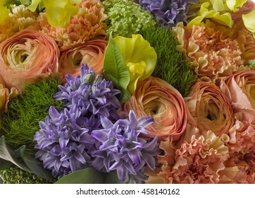 bouquet of ranunculus, hyacinth and carnations