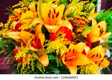 bouquet of red gerbera flower and yellow lilies