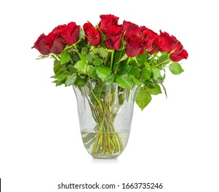 Bouquet of red long stem roses in glass vase