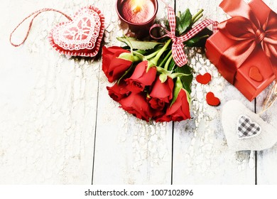Bouquet of red roses with decorative hearts and presents. St Valentine's day concept with copy space
