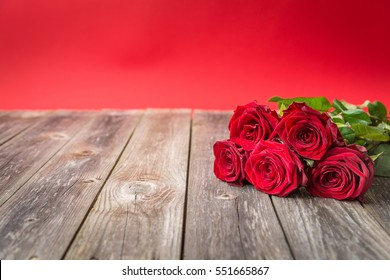 bouquet of red roses on wood background. Valentines Day background