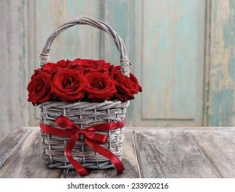 Bouquet of red roses in wicker basket