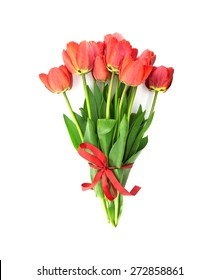 Bouquet of red tulips with red ribbon isolated on white background. Top view.