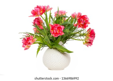 Bouquet of red tulips in a vase, isolated on white background