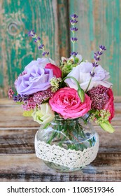 Bouquet with rose, eustoma and lavender flowers.