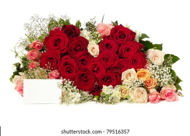 Bouquet of rose flowers with a blank gift card, isolated on white background. The roses are arranged in heart shape.
