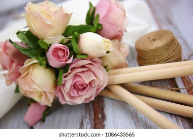 Bouquet of rose flowers on wooden table