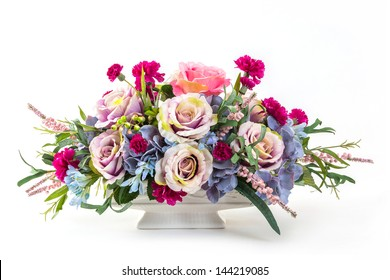 Bouquet of rose, hydrangea, berry and carnation flowers in ceramic pot