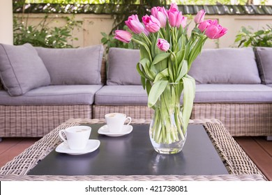 Bouquet of rose tulips on the table