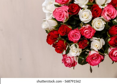 Bouquet of roses background. Wedding natural flowers. Valentines day or 8 march floral gift. Romantic love design.