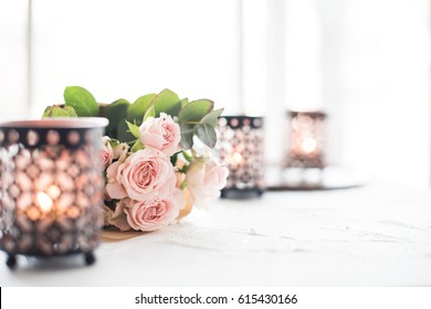 bouquet of roses and candles