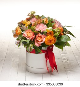 bouquet from roses, carnations,cape gooseberry and alstromeria on white background