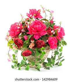 Bouquet of roses in earthern ware pot isolated on white