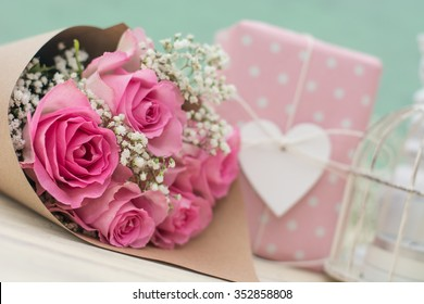 Bouquet of roses and gift