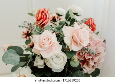Bouquet with roses and green leaves on a white background