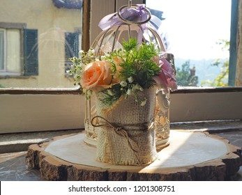 Bouquet of roses in jute cloth on wooden trunk