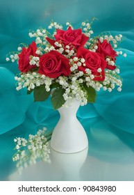 Bouquet with roses and lilies of the valley