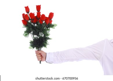 a bouquet of roses in a male hand in white shirt on white background