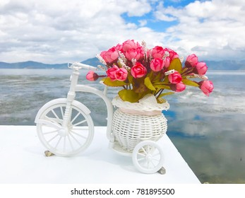 a bouquet of roses on a bicycle