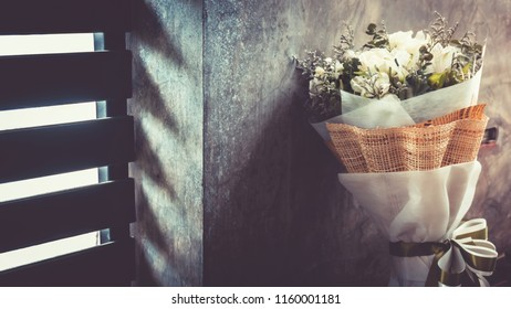 Bouquet of  roses and orchid , floral background, . Processed with vintage style.