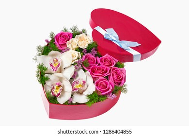 bouquet of roses and orchids in a heart-shaped box