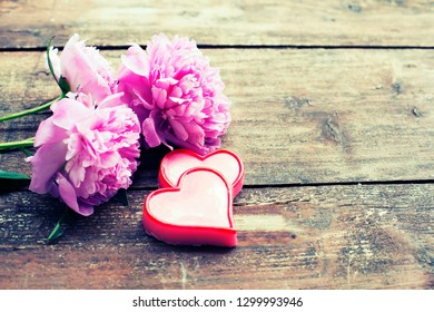 bouquet of roses and peonies on wooden board, Valentines Day background
