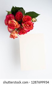 bouquet with roses in a white ceramic vase