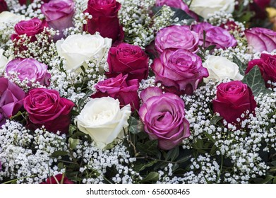 Bouquet with roses in white, pink and red