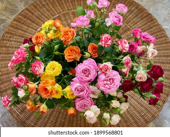 A bouquet of spray roses in mixed colors. Selective focus.