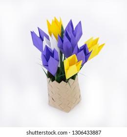 Bouquet of spring crocus origami in a wicker basket
