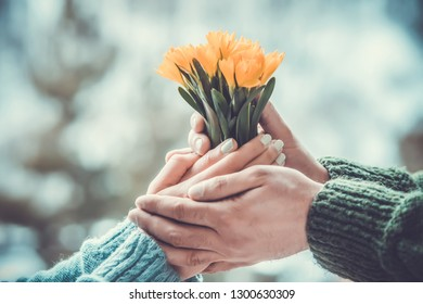bouquet of spring flowers in the hand of a man and a woman
