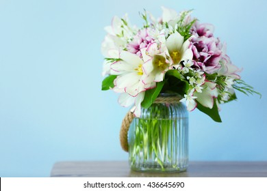 Bouquet of spring flowers on wall background