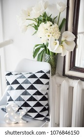 Bouquet of spring flowers in room interior, white tulips and daf