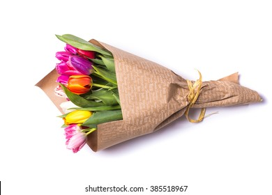 Bouquet of spring tulips with different color flowers wrapped in paper for present  isolated on white background