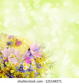 Bouquet of summer flowers with bokeh and copy space