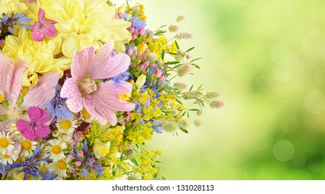 Bouquet of summer flowers with natural green  bokeh and copy space