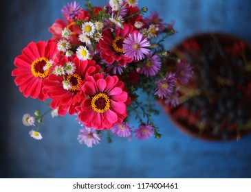 bouquet of summer flowers zinnias and chrysantemums over wooden background/birhday/love/anniversary/mothers day card